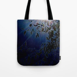 blue light and leaves Tote Bag