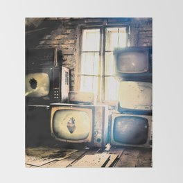 Old televisions in a dusty attic Throw Blanket