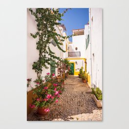 Charming cobblestone street in the whitewashed town of Tavira, Portugal Canvas Print