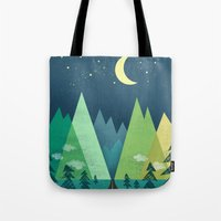 road Tote Bags featuring The Long Road at Night by Jenny Tiffany