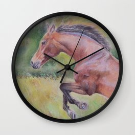 A brown horse jumping on a green meadow Pastel drawing Animal Art in the landscape Wall Clock