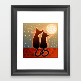 couple of cats in love on a house roof Framed Art Print