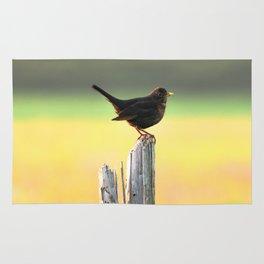 Blackbird on a Wooden Post Rug