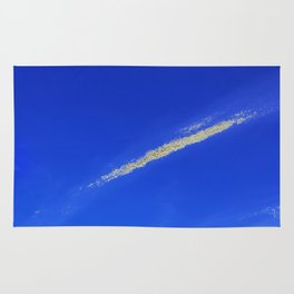 Flash of gold in the sky Rug