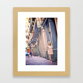Blonde girl near an old building in Barcelona Framed Art Print