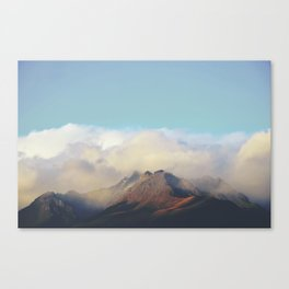 Sun kissed summit in the clouds Canvas Print
