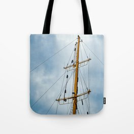 The mast of the ship against the bright sky Tote Bag