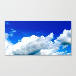 Clouds in a Clear Blue Sky Canvas Print