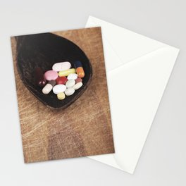 Suplement pills on old wooden spoon concept Stationery Cards