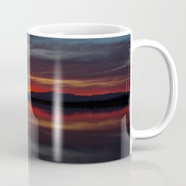 Final light of sunset turning sky and water red Coffee Mug