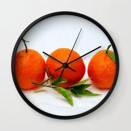 Three tangerine fruits Wall Clock