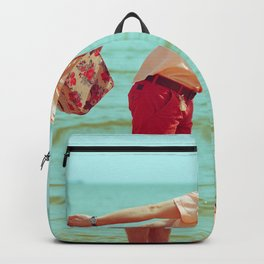 Young happy married hipsters in trendy clothes kissing on beach and holding their shoes. Couple walking on beach.  Sunny summer day. Vintage style. Romantic Backpack