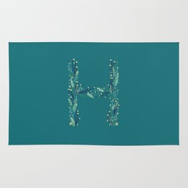 Turquoise flowers alphabet H Rug