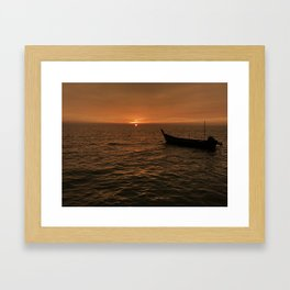 Sunset view with small boat, sampan at the seaside Framed Art Print