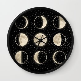 shiny moon phases on black / with stars Wall Clock