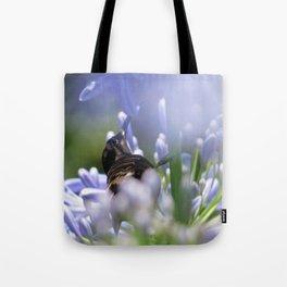 Honeybird amongst the agapanthas Tote Bag