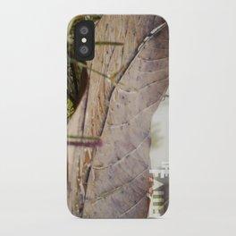 Dew drops on a fallen leaf iPhone Case