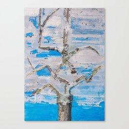 Tree in silver clouds Canvas Print