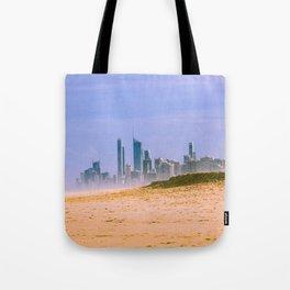 Fantasy landscape - modern city skyline over sand dune and mist Tote Bag