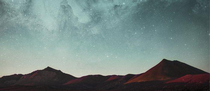 Universe above the mountain peaks Coffee Mug