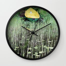 Yellow boat on lakeside Wall Clock