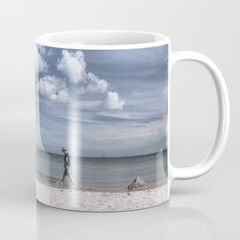 Lonely man at the beach Coffee Mug