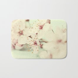 Bright pink cherry blossoms growing on a tree after the rain Bath Mat