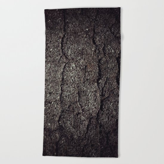 Cracked asphalt road Beach Towel