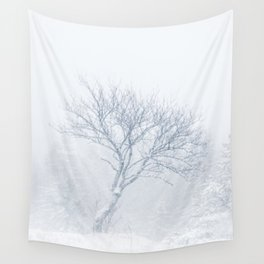Lonely tree during snow storm in winter Wall Tapestry