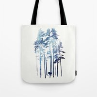 winter Tote Bags featuring Winter Wolf by Robert Farkas