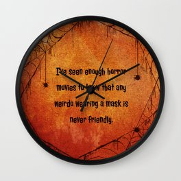 I've seen enough horror movies to know that any weirdo wearing a mask is never friendly. Wall Clock
