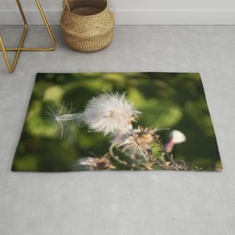 Thistle blowing in the wind Rug