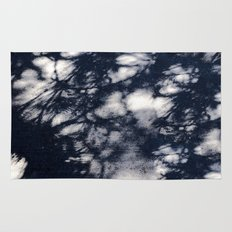 Navy Blue Pine Tree Shadows on Cement Rug