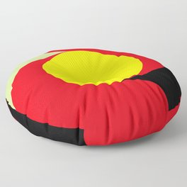 This is a sun splitting the sky in two sides, one black, one green. Spitting deep red round rays. Floor Pillow