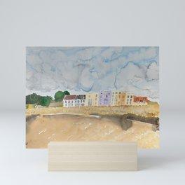 Seaside Apartments Under A Cloudy Sky Mini Art Print