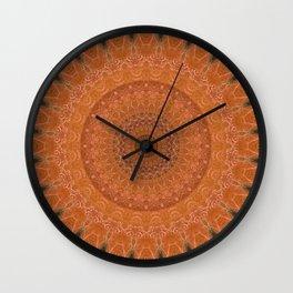Ornamented mandala in orange tones Wall Clock