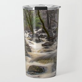Bridalveil Creek, Yosemite National Park is swollen with snowmelt runoff on an early Spring morning Travel Mug