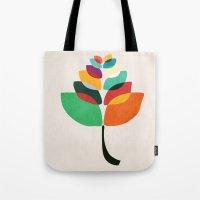 lotus flower Tote Bags featuring Lotus flower by Picomodi