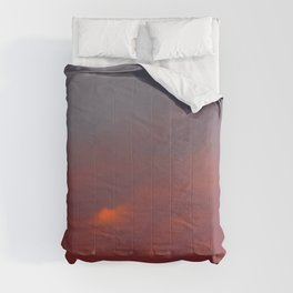 Red cloud shining at sunset Comforters