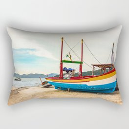 Colorful wooden fishing boat at the beach in Porto Belo, Brazil. Rectangular Pillow