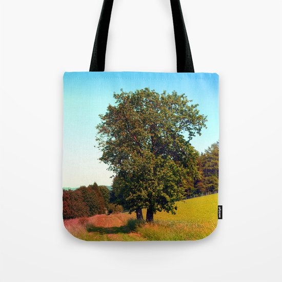 Old tree, vibrant surroundings Tote Bag