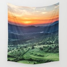 Beautiful sunset behind green fields Wall Tapestry