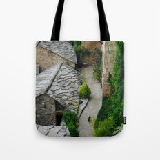 Old town and a cat Tote Bag