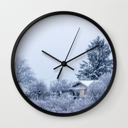 Snowy winter cabin in the woods Wall Clock