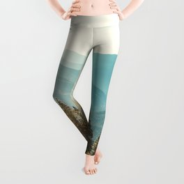 Peaceful landscape, mountains and blue sky background.  Leggings
