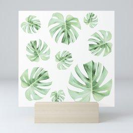 Tropical green leaves on white Mini Art Print