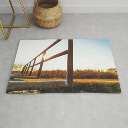 Bridge over an irrigation channel of the Lomellina at sunset Rug