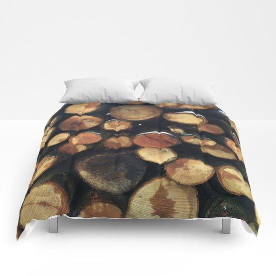 Pile of felled tree trunks Comforters