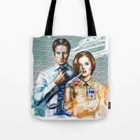 mulder Tote Bags featuring Mulder and Scully by Tatiana Anor