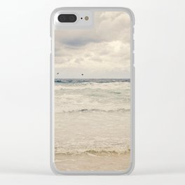 Seagulls take flight over the sea. Clear iPhone Case